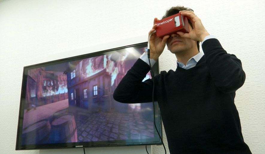This Feb. 2, 2016 image made from video shows Timelooper co-founder Yigit Yigiter looking through a Google cardboard virtual reality headset as he sees a recreation of the Great Fire of London in 1666. The Timelooper app allows users to experience key moments in London history with just a smartphone and a cardboard headset. (AP Photo)