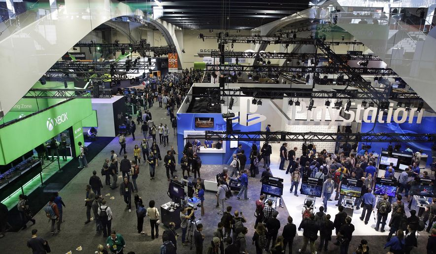 In this March 4, 2015, photo, people walk through the exhibit hall at the Game Developers Conference in San Francisco. The 30th annual Game Developers Conference runs from March 14 - 18, 2016, at Moscone Center in San Francisco. (AP Photo/Eric Risberg, File)