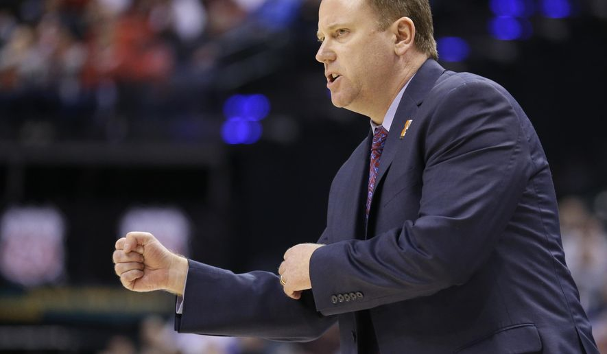FILE - In this March 10, 2016, file photo, Wisconsin's head coach Greg Gard directs his team in the first half of an NCAA college basketball game against Nebraska at the Big Ten Conference tournament, in Indianapolis. In making Greg Gard the full-time basketball coach, Wisconsin has turned the program over to a native son, just like with the football program and coach Paul Chryst.(AP Photo/Michael Conroy, File)