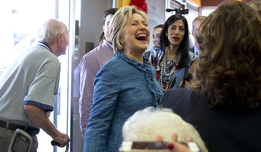 Democratic presidential candidate Hillary Clinton laughs with patrons during a visit to Dunkin' Donuts in West Palm Beach, Fla., on March 15, 2016. (Associated Press) **FILE**