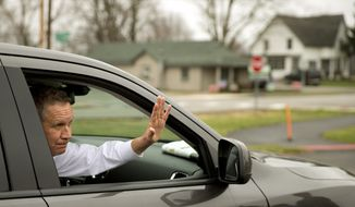 Republican presidential candidate, Ohio Gov. John Kasich, waves as he departs his polling place after he cast his ballot in the primary election Tuesday, March 15, 2016, in Westerville, Ohio. (AP Photo/Matt Rourke)
