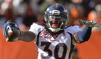 Denver Broncos strong safety David Bruton (30) celebrates an interception during the second half of an NFL football game against the Cleveland Browns, Sunday, Oct. 18, 2015, in Cleveland. (AP Photo/David Richard)