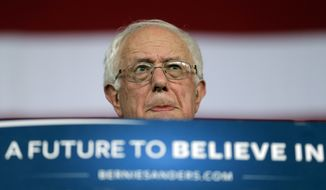 """""""If you want to vote for me, great. If you don't, that's OK,"""" Sen. Bernard Sanders said. """"But what I do not want to see is billionaires spending unlimited sums of money buying elections and undermining the democracy which has made our country so great."""" (Associated Press)"""