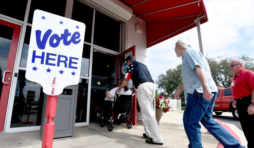 Voters walk into the Destin Community Center in Florida in this Tuesday, March 15, 2016, file photo. (Nick Tomecek/Northwest Florida Daily News via AP) ** FILE **