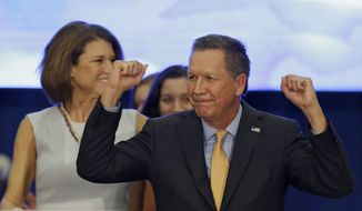 Republican presidential candidate, Ohio Gov. John Kasich pumps his fist before speaking at his presidential primary election rally in Berea, Ohio, on Tuesday, March 15, 2016. (AP Photo/Tony Dejak)