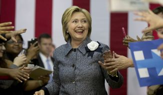 Democratic presidential candidate Hillary Clinton arrives to a cheering crowd to speak at a campaign event at the Grady Cole Center in Charlotte, N.C., Monday, March 14, 2016. (AP Photo/Carolyn Kaster)