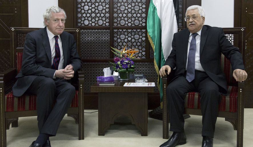 Palestinian President Mahmoud Abbas, right meets with French special envoy Pierre Vimont, at his office in the West Bank city Ramallah, Tuesday, March 15, 2016. (AP Photo/Nasser Nasser)