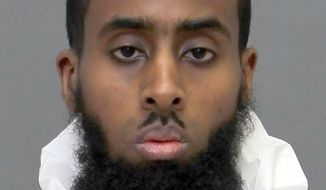 This undated image provided by the Toronto Police Service shows Ayanle Hassan Ali, who has been charged with attempted murder, aggravated assault and several other counts, according to court documents. The 27-year-old Canadian man said Allah sent him to stab two soldiers at a military recruitment center in Toronto, according to police. (Toronto Police Service/The Canadian Press via AP)
