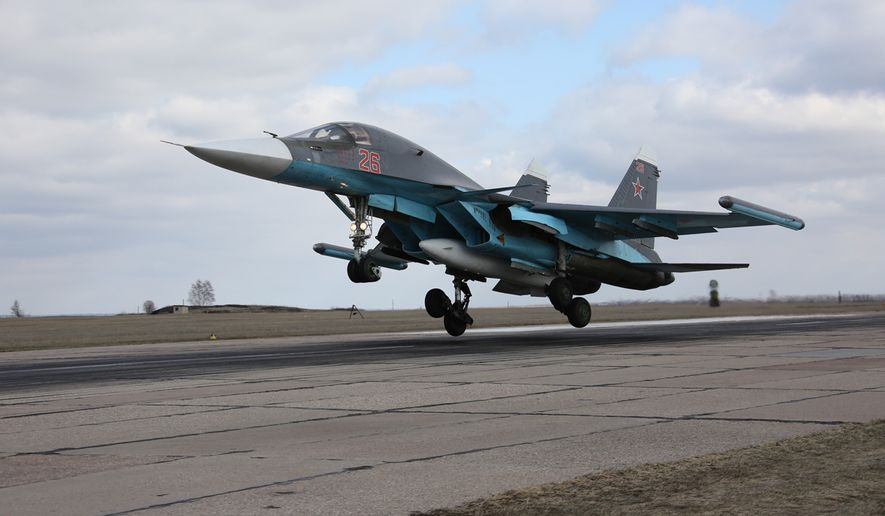 In this photo provided by the Russian Defense Ministry Press Service, Russian Su-34 bomber lands after returning from Syria at an airbase near the Russian city Voronezh, Tuesday, March 15, 2016. Russian warplanes and troops stationed at Russia's air base in Syria started leaving for home on Tuesday after a partial pullout order from President Vladimir Putin the previous day, a step that raises hopes for progress at the newly reconvened U.N.-brokered peace talks in Geneva. (Olga Balashova/Russian Defense Ministry Press Service via AP)