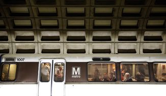 Riders sit in a Metro train in the Gallery Place-Chinatown station in Washington on March 15, 2016. (Associated Press) **FILE**