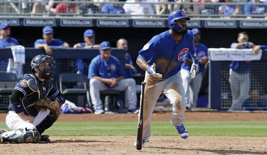 Chicago Cubs' Jason Heyward watches a three-run double during the third inning of a spring training baseball game against the San Diego Padres on Tuesday, March 15, 2016, in Peoria, Ariz. (AP Photo/Darron Cummings)