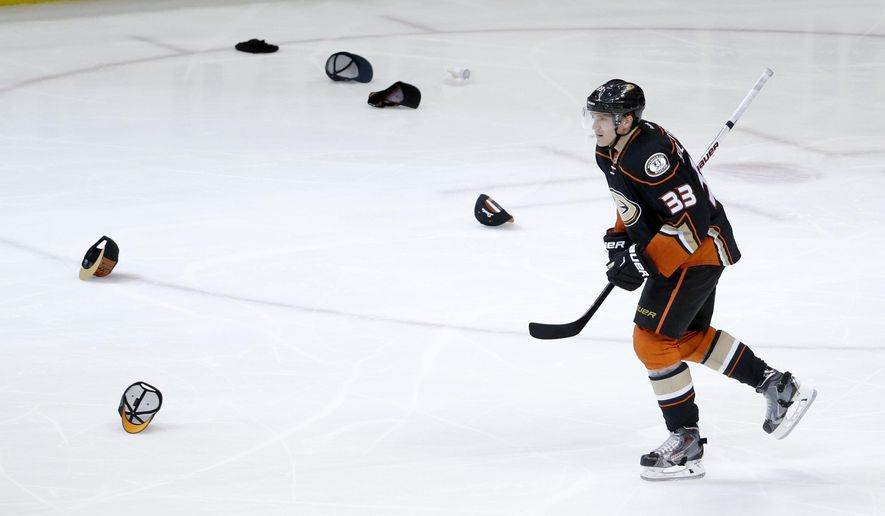 Anaheim Ducks left wing Jakob Silfverberg celebrates his hat trick against the New Jersey Devils during the third period of an NHL hockey game in Anaheim, Calif., Monday, March 14, 2016. (AP Photo/Chris Carlson)