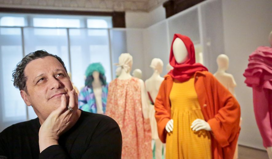Fashion designer Isaac Mizrahi discuss his creations during a press preview tour of his exhibition at the Jewish Museum on Monday, March 14, 2016, in New York. (AP Photo/Bebeto Matthews)