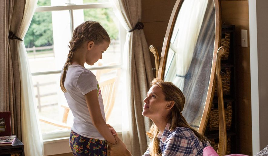 """This image released by Sony Pictures shows Kylie Rogers, left, and Jennifer Garner in a scene from Columbia Pictures', """"Miracles from Heaven.""""  (Chuck Zlotnick/Sony Pictures via AP)"""