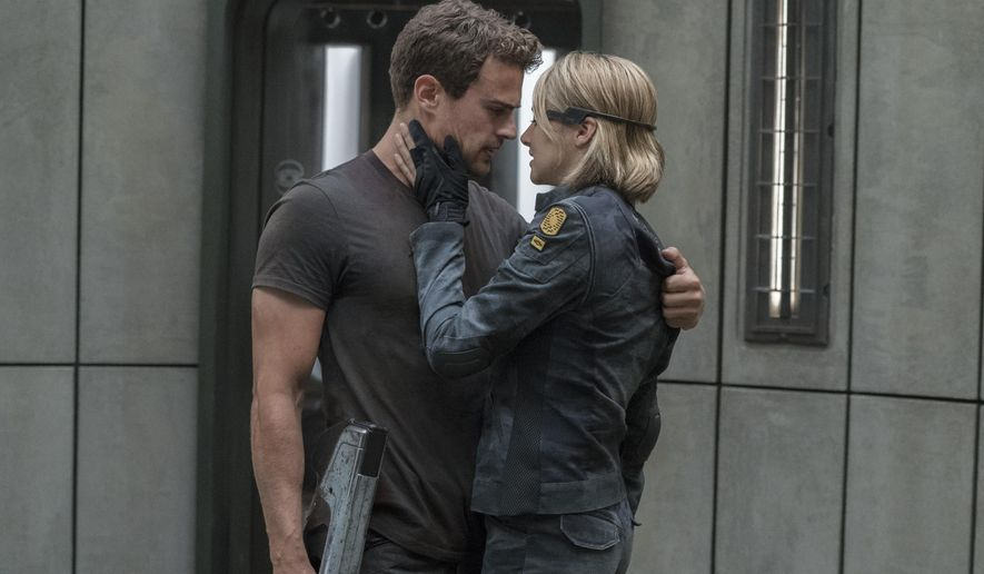 """This image released by Lionsgate shows Shailene Woodley, right, and Theo James in a scene from """"The Divergent Series: Allegiant."""" (Murray Close/Lionsgate via AP)"""