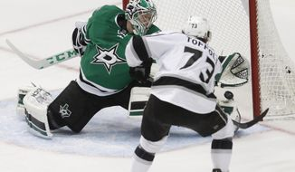Los Angeles Kings center Tyler Toffoli (73) scores on Dallas Stars goalie Kari Lehtonen (32) during the first period of an NHL hockey game, Tuesday, March 15, 2016, in Dallas.  (AP Photo/Tim Sharp)