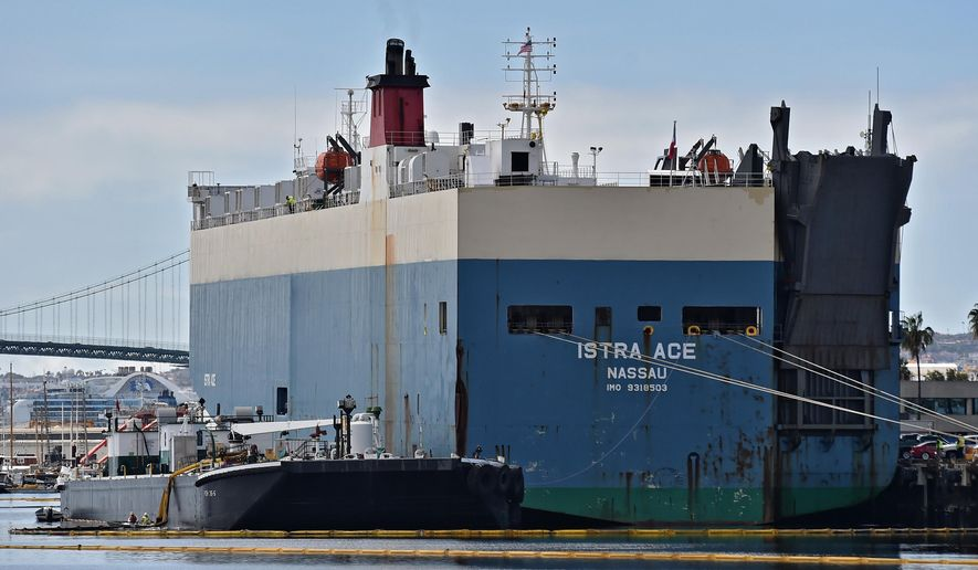 Oil absorbent booms are set up near cargo ship Istra Ace, where oil sheen was visible in the Wilmington Marina in the East Basin of the Cerritos Channel in Los Angeles Harbor on Monday, March 14, 2016. Cleanup efforts are under way after a large cargo ship leaked an unknown amount of oil in the harbor. (Robert Casillas/The Daily Breeze via AP) MANDATORY CREDIT
