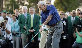 FILE - In this April 9, 2015, file photo, Arnold Palmer hits an honorary tee shot before the first round of the Masters golf tournament, in Augusta, Ga. Arnold Palmer will be on the first tee to help start the Masters this year _ but without his golf clubs. Palmer said Tuesday, March 15, 2016, that he has told Augusta National he will not be hitting the ceremonial tee shot to start the Masters this year. (AP Photo/Matt Slocum, File)