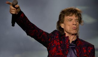 Mick Jagger performs during the Rolling Stones' Ole Tour at Foro Sol in Mexico City, Monday, March 14, 2016. (AP Photo/Eduardo Verdugo)