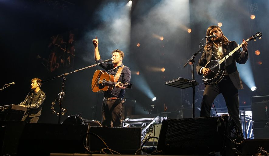 In this Aug. 17, 2015, file photo, Ben Lovett, from left, Marcus Mumford and Winston Marshall of Mumford & Sons perform in Inglewood, Calif. (Photo by Rich Fury/Invision/AP, File)