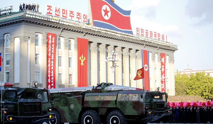 FILE - In this Oct. 10, 2015, photo, missiles are paraded during a military parade during celebrations to mark the 70th anniversary of North Korea's Workers' Party. Skeptics of North Korea's nuclear threat - and there are many - have long clung to two comforting thoughts: that while the North has the bomb, it doesn't have a warhead small enough to put on a long-range rocket, much less a re-entry vehicle to keep that warhead from burning up in the atmosphere before it could reach a target like, as it has suggested before, Manhattan. North Korea on Tuesday, March 15, 2016, suggested it will soon show the world it has mastered both technologies. (AP Photo/Wong Maye-E, File)