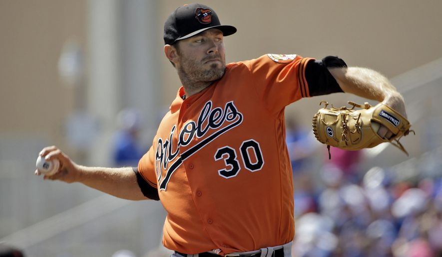 Baltimore Orioles starting pitcher Chris Tillman (30) throws against the Toronto Blue Jays during the first inning of a spring training baseball game Tuesday, March 15, 2016, in Dunedin, Fla. (AP Photo/Chris O'Meara)