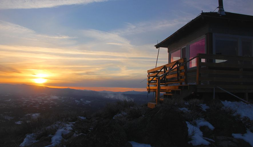 This Feb. 26, 2016 photo shows Hager Mountain Lookout at sunset in south-central Oregon near Silver Lake. Spending the night here requires making reservations well in advance and snowshoeing up a steep mountain to 7,166 feet. (Zach Urness/Statesman-Journal via AP) MANDATORY CREDIT