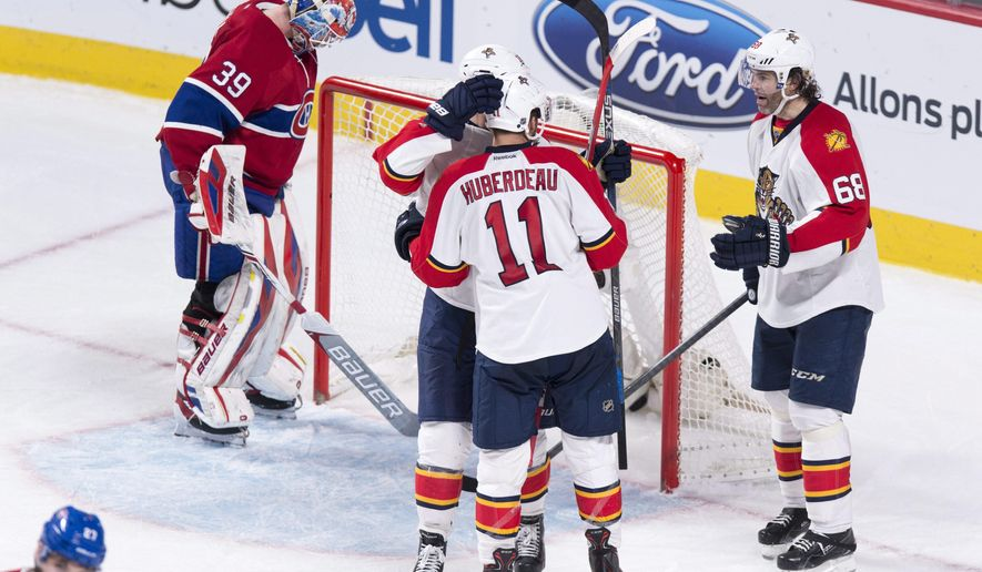 Florida Panthers' Aleksander Barkov, center rear, is congratulated by teammates Jonathan Huberdeau and Jaromir Jagr, right, following a goal against Montreal Canadiens goalie Mike Condon during the third period of an NHL hockey game Tuesday, March 15, 2016, in Montreal. (Paul Chiasson/The Canadian Press via AP)
