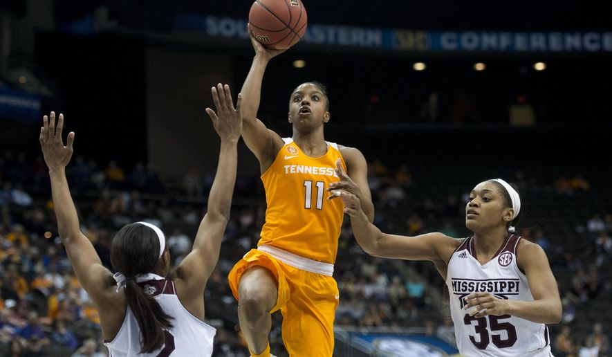 FILE- In this March 5, 2016, file photo, Tennessee's Diamond DeShields attempts to score while defended by Mississippi State's Morgan William, left, and Victoria Vivians during an NCAA college basketball game in the Southeastern Conference women's tournament in Jacksonville, Fla. Tennessee heads into the NCAA Tournament embracing its unfamiliar role as a potential underdog. After a disappointing regular season Tennessee is seeded seventh in the Sioux Falls Regional on Monday, March 14, 2016.  (Saul Young/Knoxville News Sentinel via AP, File) MANDATORY CREDIT