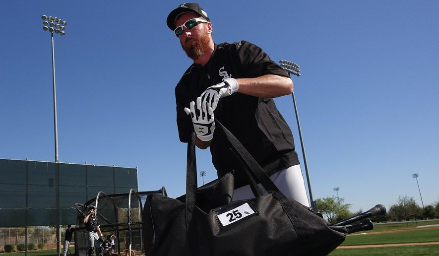 FILE - In this Feb. 26, 2016, file photo, Chicago White Sox's Adam LaRoche picks up his gear after taking live batting practice during a spring training baseball workout in Glendale, Ariz. LaRoche surprised the White Sox by retiring Tuesday, March 15, 2016, leaving $13 million on the table. (AP Photo/Ross D. Franklin, File)