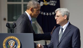 Federal appeals court judge Merrick Garland shakes hands with President Barack Obama as he is introduced as Obama's nominee for the Supreme Court during an announcement in the Rose Garden of the White House, in Washington, Wednesday, March 16, 2016. Garland, 63, is the chief judge for the United States Court of Appeals for the District of Columbia Circuit, a court whose influence over federal policy and national security matters has made it a proving ground for potential Supreme Court justices. (AP Photo/Pablo Martinez Monsivais)