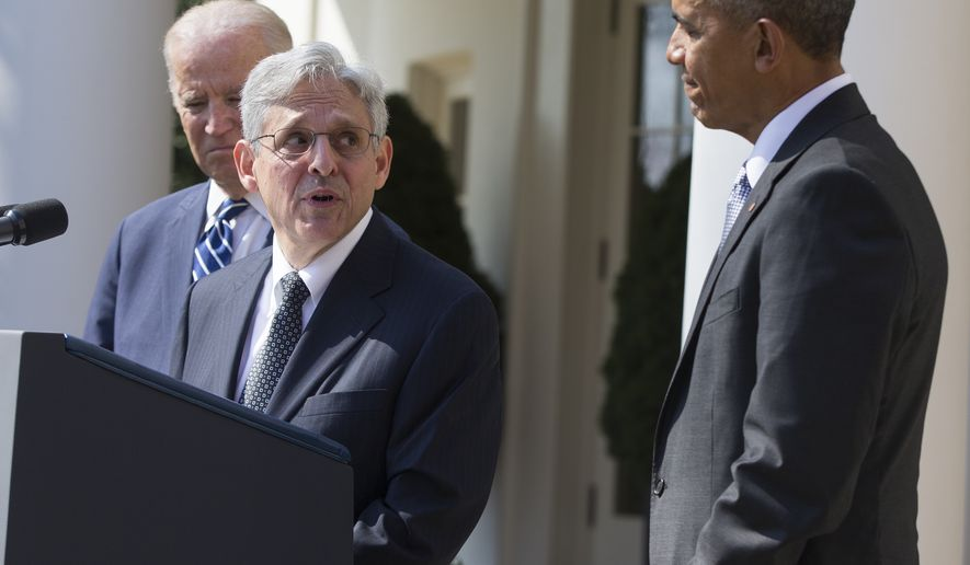 Federal appeals court judge Merrick Garland, center, speaks as President Barack Obama, right, and Vice President Joe Biden look on after he was introduced as Obama's nominee for the Supreme Court during an announcement in the Rose Garden of the White House, on Wednesday, March 16, 2016, in Washington. (AP Photo/Evan Vucci)