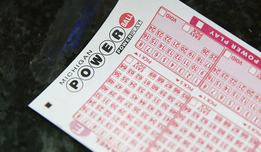 A Powerball ticket is shown at Coach Liquor in Detroit, Wednesday, Jan. 13, 2016.  The estimated Powerball jackpot will be over billion dollars.  (AP Photo/Paul Sancya)