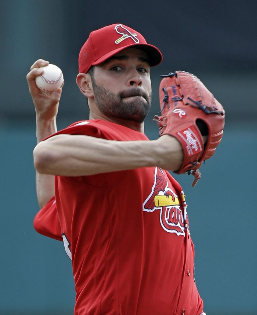 St. Louis Cardinals pitcher Jaime Garcia throws in the first inning in a spring training baseball game against the Atlanta Braves, Wednesday, March 16, 2016, in Kissimmee, Fla. (AP Photo/John Raoux)