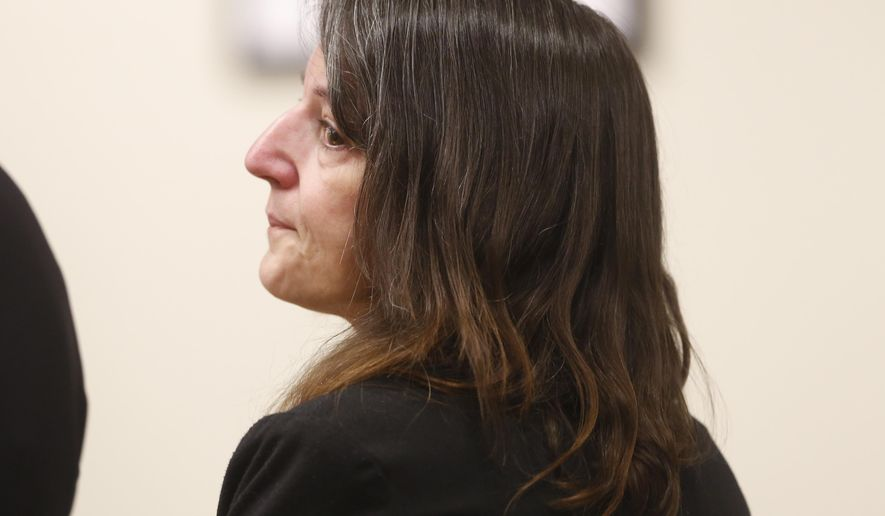 Michelle Lodzinski watches the jurors enter the courtroom before opening statements in her murder trial on Wednesday, March 16, 2016 in New Brunswick, N.J. Lodzinski is charged with killing her 5-year-old son, Timothy Wiltsey in 1991.  (Patti Sapone/NJ Advance Media via AP, Pool)