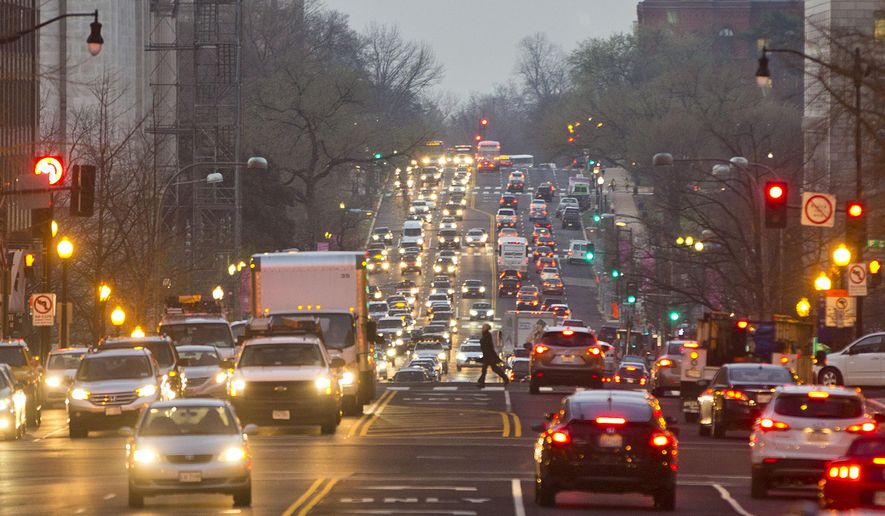 Morning traffic builds up on 14th street NW in downtown Washington, Wednesday, March 16, 2016.  (AP Photo/Pablo Martinez Monsivais) **FILE**