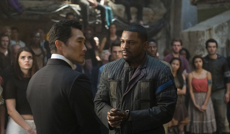 """This image released by Lionsgate shows Daniel Dae Kim, left, and Mekhi Phifer in a scene from """"The Divergent Series: Allegiant."""" (Murray Close/Lionsgate via AP)"""