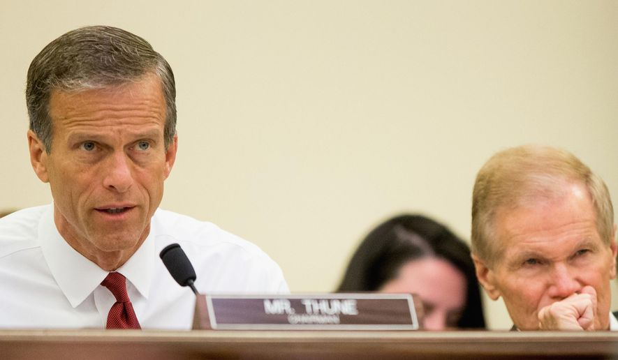FILE - In this June 10, 2015, file photo, chairman John Thune, R-S.D., left, speaks during a Senate Commerce, Science and Transportation hearing on Capitol Hill in Washington. Also pictured is Ranking member Bill Nelson, D-Fla., right. The Senate panel has approved an aviation policy bill March 16 after a partisan fight over whether airlines are unfairly gouging consumers with fees for basic services like checked bags, seat assignments and ticket changes. (AP Photo/Andrew Harnik, File)