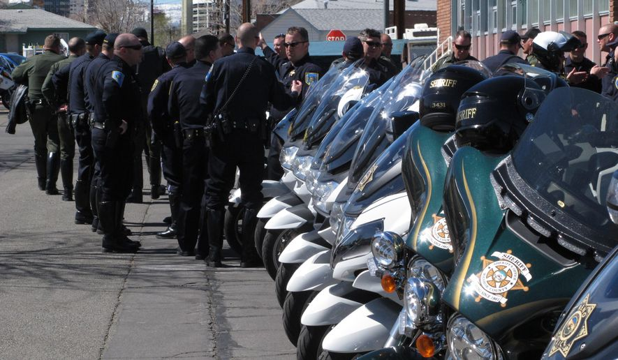 Law officers from throughout the region get a briefing in Reno, Nevada, Wednesday, March 16, 2016 before leaving on a 120-mile funeral procession from Reno to Roseville, Calif., for officer Nathan Taylor, a California highway patrolman killed in the line of duty. Taylor, 35, died at a Reno hospital on March 13, after he was struck by a car on Interstate 80 while directing traffic during a snowstorm in the Sierra. (AP Photo/Scott Sonner)