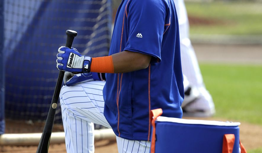 FILE - In this Feb. 26, 2016, file photo, New York Mets' Ruben Tejada prepares to take batting practice during a spring training baseball workout in Port St. Lucie, Fla. The Mets released Tejada on Wednesday, March 16, 2016. Tejada will receive $491,803, which is 30 days' termination pay, rather than the $3 million salary under the contract he agreed to on Jan. 15. (AP Photo/Jeff Roberson, File)