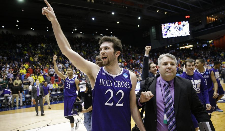 Holy Cross' Robert Champion (22) celebrates after the team's First Four game against Southern University in the NCAA college basketball tournament Wednesday, March 16, 2016, in Dayton, Ohio. Holy Cross won 59-55. (AP Photo/John Minchillo)
