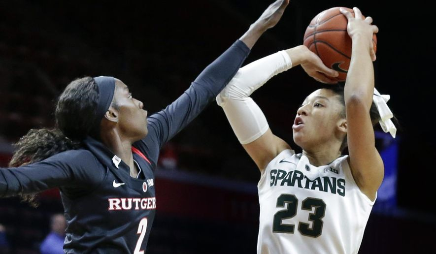 FILE - In this Feb. 18, 2016, file photo, Michigan State forward Aerial Powers (23) shoots over Rutgers forward Kahleah Copper (2) during the first half of an NCAA college basketball game in Piscataway, N.J. Powers leads fourth-seeded Michigan State into the NCAA tournament just five points away from becoming the school's all-time leading scorer. With the record and a degree in hand this spring, there's a chance the redshirt junior might enter the WNBA draft. (AP Photo/Mel Evans, File)