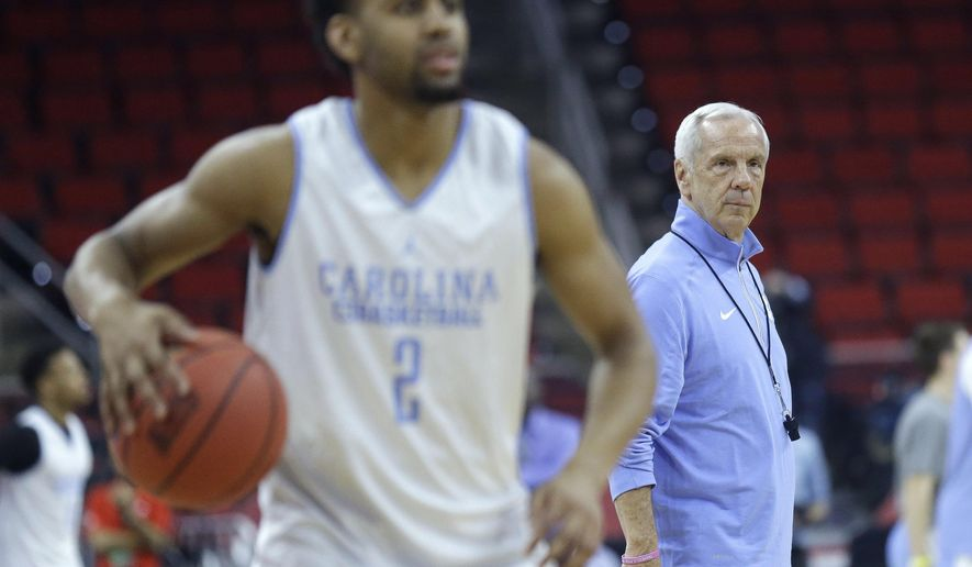 North Carolina coach Roy Williams watches as Joel Berry II dribbles during practice for an NCAA college basketball first-round tournament game in Raleigh, N.C., Wednesday, March 16, 2016. North Carolina plays Florida Gulf Coast on Thursday. (AP Photo/Gerry Broome)
