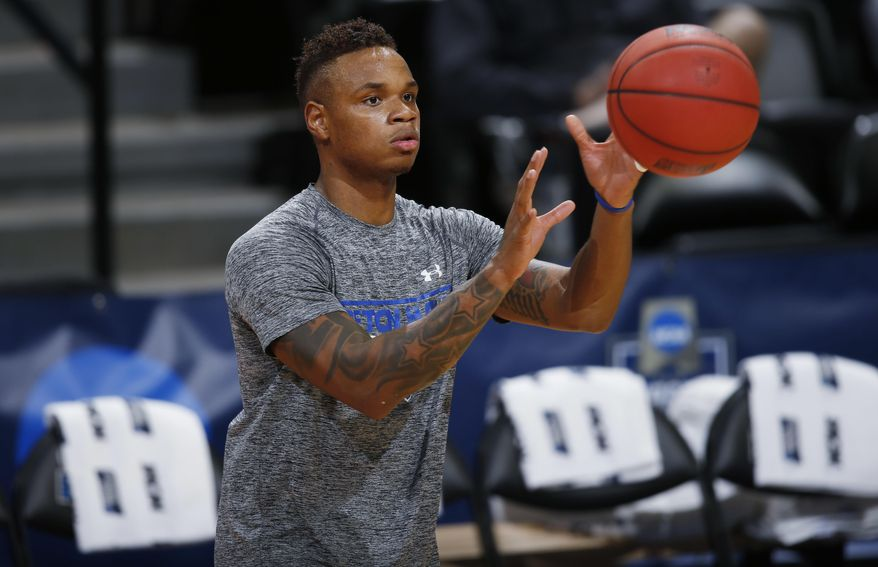 Seton Hall guard Derrick Gordon fields a pass during practice for a first-round men's college basketball game Wednesday, March 16, 2016, in the NCAA Tournament in Denver. Seton Hall faces Gonzaga on Thursday. (AP Photo/David Zalubowski)