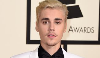 Justin Bieber arrives at the 58th annual Grammy Awards in Los Angeles, in this Feb. 15, 2016, file photo. (Photo by Jordan Strauss/Invision/AP, FIle)