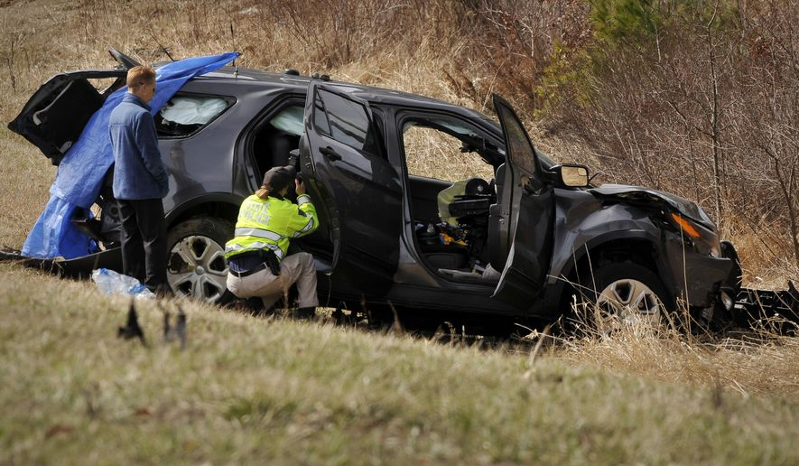 Massachusetts State Police takes photographs of an heavily-damaged unmarked state police cruiser during their investigation of a serious accident on the Massachusetts Turnpike east of exit 9 on Wednesday, March 16, 2016. Massachusetts State Police trooper, Thomas Clardy, who was injured in the crash on the Massachusetts Turnpike has died, according to authorities. (Paul Kapteyn/Worcester Telegram & Gazette via AP) MANDATORY CREDIT