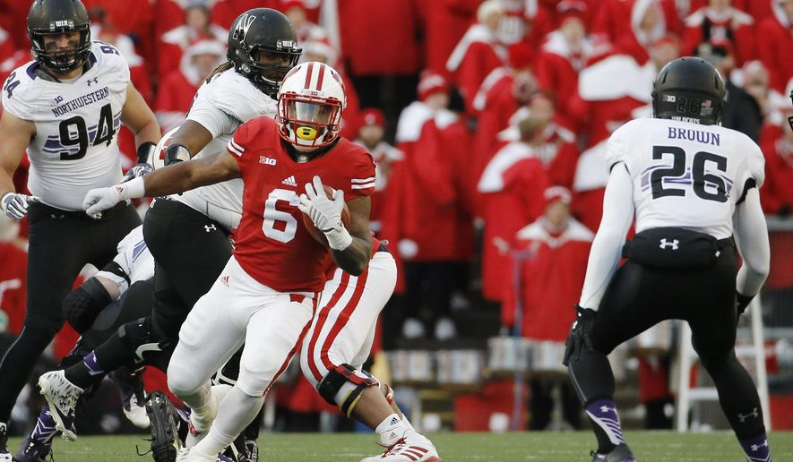 FILE - In this Nov. 21, 2015 file photo, Wisconsin's Corey Clement runs during an NCAA college football game against Northwestern in Madison, Wis. Wisconsin Clement is making a fresh start with a new number. He has switched to No. 24 in spring practice after wearing No. 6 the previous three seasons. (AP Photo/Morry Gash, File)