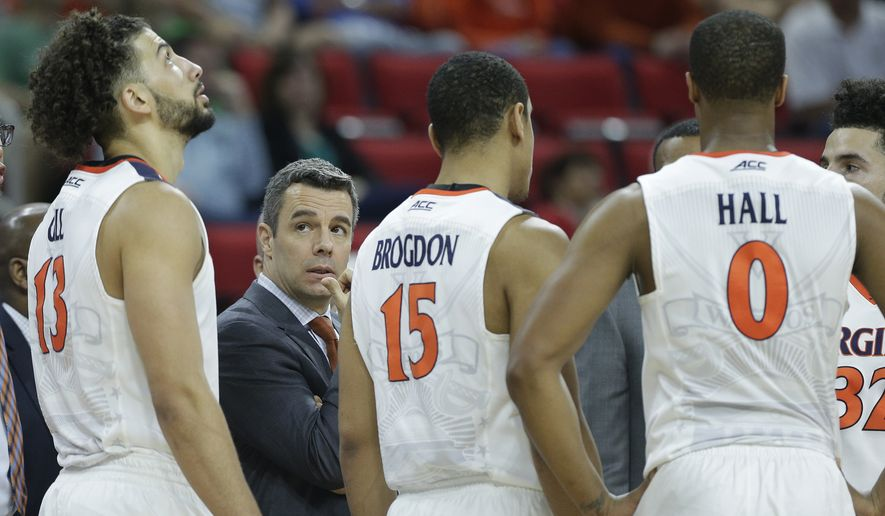 Virginia head coach Tony Bennett speaks to players during the second half of a first-round men's college basketball game in the NCAA Tournament between Virginia and Hampton, Thursday, March 17, 2016, in Raleigh, N.C. (AP Photo/Chuck Burton)