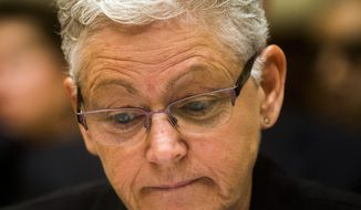 Environmental Protection Agency Administrator Gina McCarthy listens during a hearing about the Flint water crisis in front of the U.S. House Committee on Government Oversight and Reform at the Rayburn House Office Building on Thursday, March 17, 2016 in Washington. Michigan Gov. Rick Snyder on Thursday blamed career bureaucrats in Washington and his own state for the Flint water-contamination crisis, while the head of the federal Environmental Protection Agency faulted him and other state officials. (Jake May/The Flint Journal-MLive.com via AP)