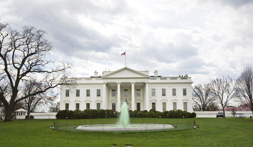 The fountain on the North Lawn of the White House in Washington, is dyed green in honor of St. Patrick's Day, Thursday, March 17, 2016. (AP Photo/Pablo Martinez Monsivais)